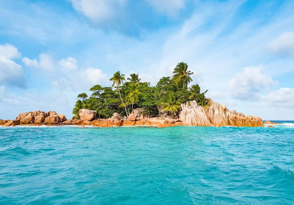 idyllic small tropical island desert island tropical island islands beach blue cloud coastline t20 G01l13